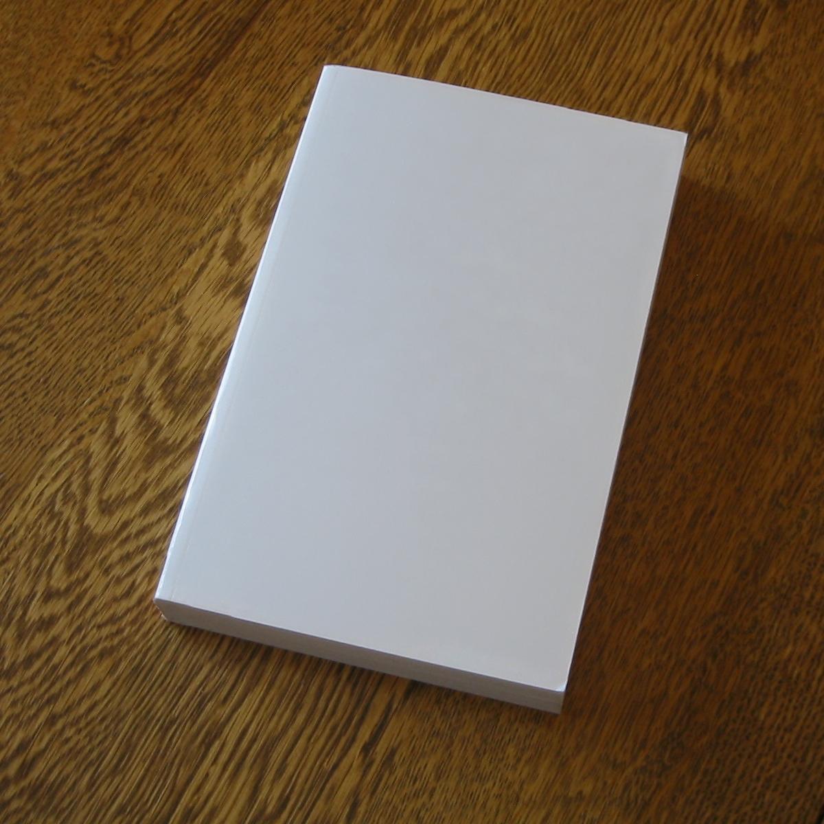 Blank_book_on_a_table.jpg